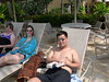 Katie and Chris relaxing by the pool.