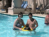 Katie and Chris take Jonathan for a swim in the pool, using a floaty toy loaned to them by another family.