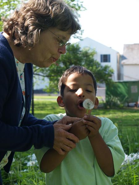 Grandma & Christian blowing dandelion