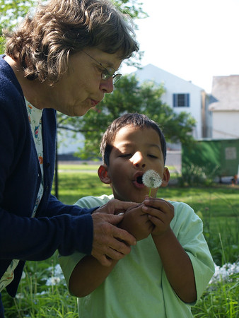 Grandma & Christian blowing dandelion