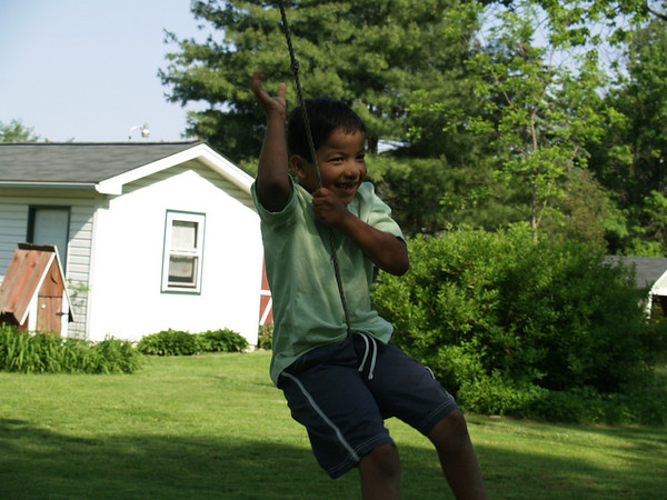 Christian swinging at Yoders'