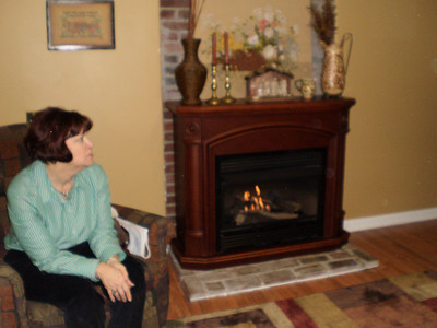 Janet and new fireplace in the basement