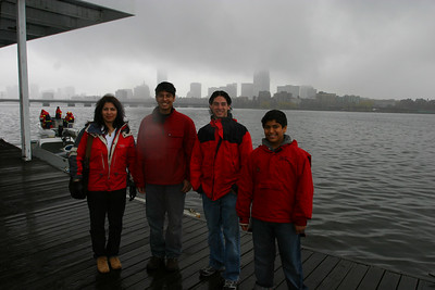 The weather was dreadful.  Everyone was fitted out in rain gear..  Picture on the MIT boathouse with the Boston skyline in the back.