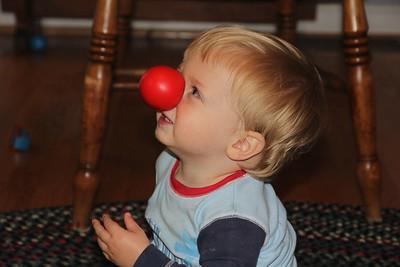 Granddad put a red nose on Elliot
