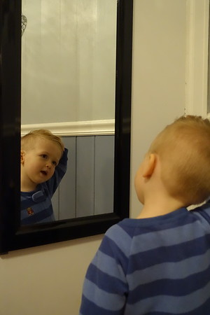 checking out his hair in Nana's mirror