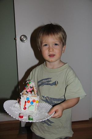 Elliot's gingerbread house he made at school (and obviously something good for lunch on his face)