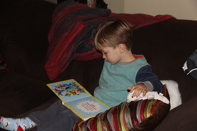 loves his superhero book