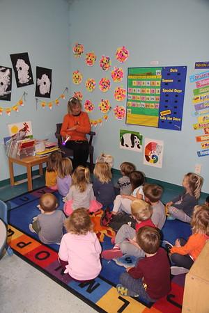 Melanie reads to Elliot's Class