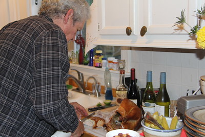 Ed in Catherine's kitchen carving the turkey he smoked - Thanksgiving 2018