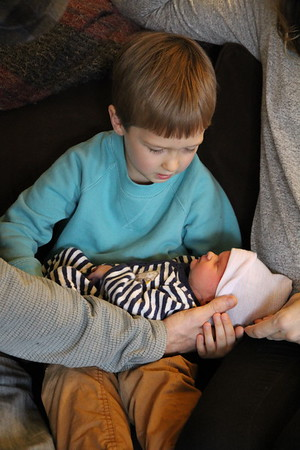 Elliot's first time to hold baby brother Arlo