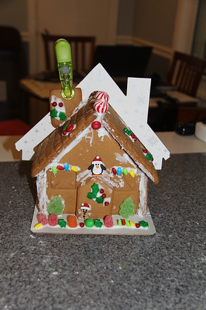 trying to get the chimney to stay on the gingerbread house