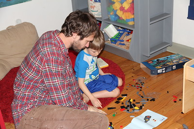 Dad helps with the assembly of the Lego birthday set from Sonya & Edward