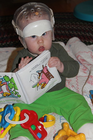 never to young to read (even tho the book is upside down)
