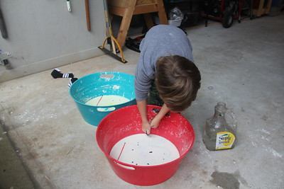 adding food coloring to the cornstarch and water