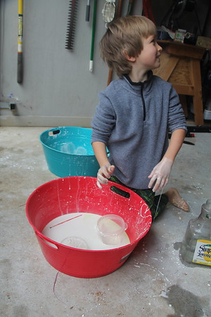 paint brushes & cups weren't enough - had to put his hands in it