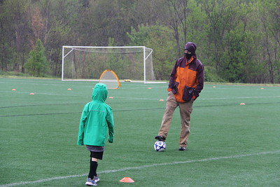 soccer practice and game in the rain