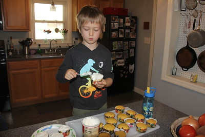 icing the cupcakes for Arlo's birthday