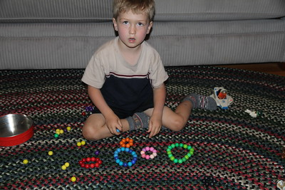 sortingthe magnetic marbles into color groups (where does this trait come from?)