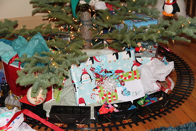 Catherine still uses the tree skirt Aunt Chee made and Elliot fills the train cars (also from Aunt Chee)