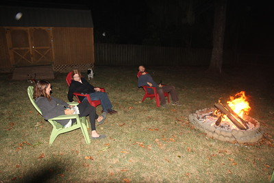 Catherine, Jan & Drew around the bonfire