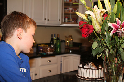 Aaron eyes Edward's birthday cake
