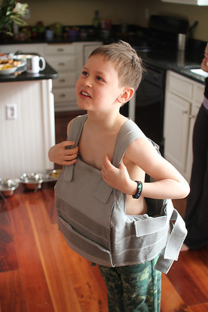 Aaron feeling how heavy his Dad's flak jacket is (very heavy)