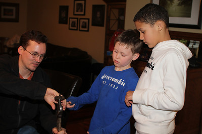 showing the boys how to clasp the sword