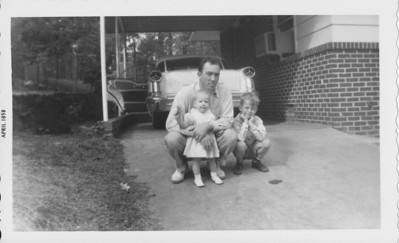 Dad, with Anita in his arms and Adrian, Jr., to the right. - 1958. Forrest Hills, Montgomery, AL -  Nice car.