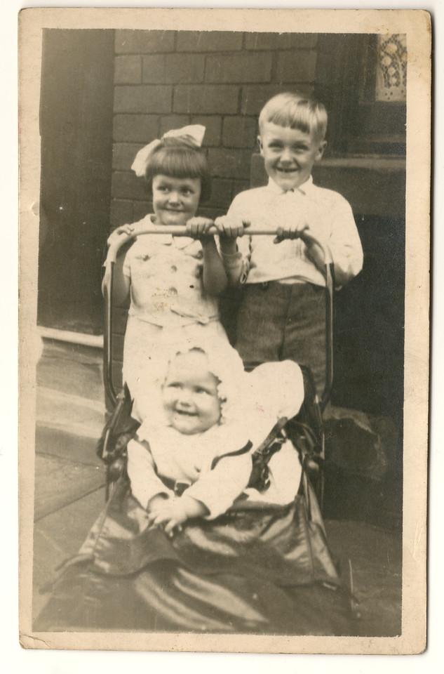 Gordon, a neighbour's child, and Brenda in pram