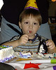 Matthew eating cake at his party