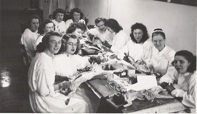 In a class or nursing, dissecting cats, in the basement of the San Jose School of nursing. Marcia is at the far right.