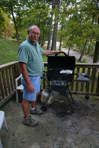 In our rented cabin  at Eminence, Missouri, Allan is working on the evenings Bar-B-Q.