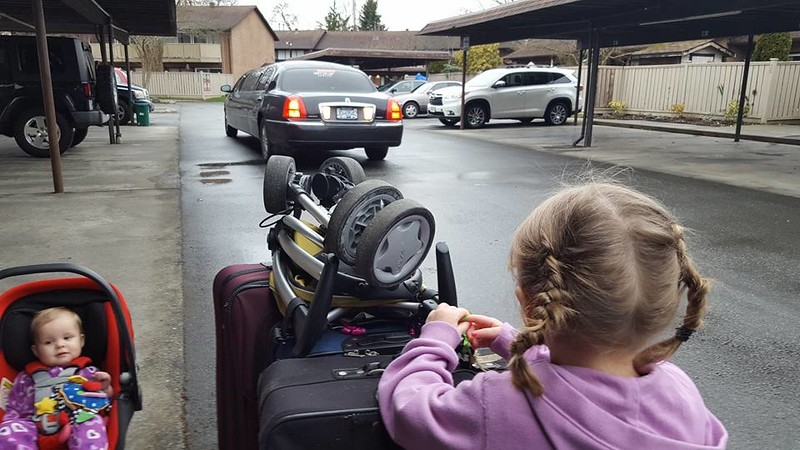 Maddy and Emily waiting for the limo to back up to take them to the airport in Vancouver.....leaving the rain behind !!