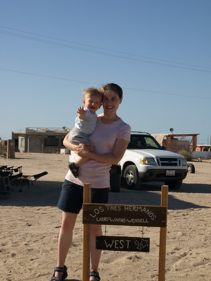 Mommy and Cody at the sign in front of Larry's place.