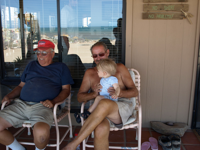 Cody sits on Papa Wayne's lap.