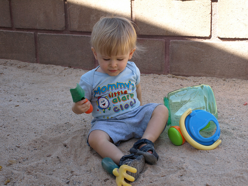 As soon as Cody got out of the car he sat down and started playing in the sand. 6/7/07