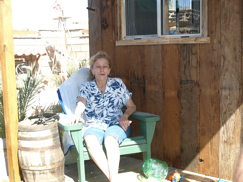 Mom in front of Ruthann's craft shack.