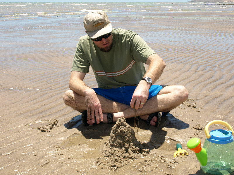 Daddy is such a good sand castle maker!