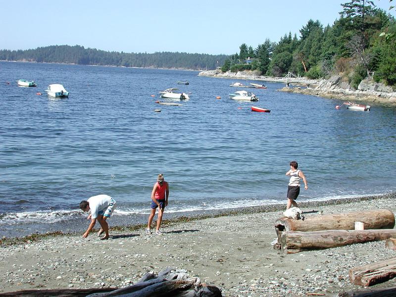 Skipping rocks at Bowen Bay.<br /> Warren, Nicole and Martha