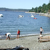 Skipping rocks at Bowen Bay.<br /> Warren, Nicole and Martha