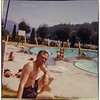 Bill was watching the kids taking swimming lessons at the pool then they would go into the ocean at Sandy Beach.