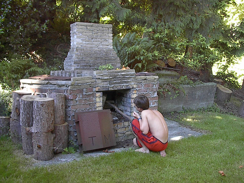 Brian Bako checking out the backyard BBQ. I do not remember it ever working.
