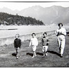 Ian, Martha, Eileen and Mum (Mary) walk along the sea wall heading to feed the ducks in the Lagoon and to climb the ROCK!