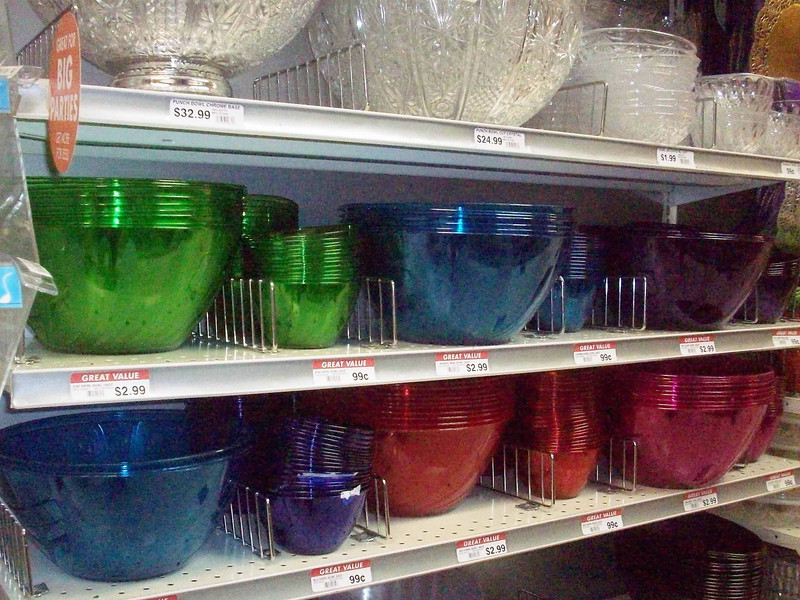 """Large, inexpensive plastic bowls suitable for chips and dip etc.  All the solid colors.  They are translucent and kinda purty.  As you can see on the top shelf, there are plastic """"crystal"""" bowls that are real purty but cost more."""