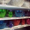 "Large, inexpensive plastic bowls suitable for chips and dip etc.  All the solid colors.  They are translucent and kinda purty.  As you can see on the top shelf, there are plastic ""crystal"" bowls that are real purty but cost more."