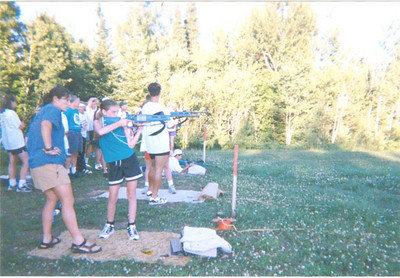 Learning biathlon at a ski camp in middle school.