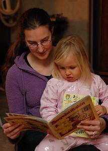 Jennifer, Dennis' wife, reading to Frankie.