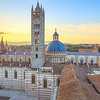 Siena sunset panoramic view. Cathedral Duomo landmark. Tuscany, Italy.