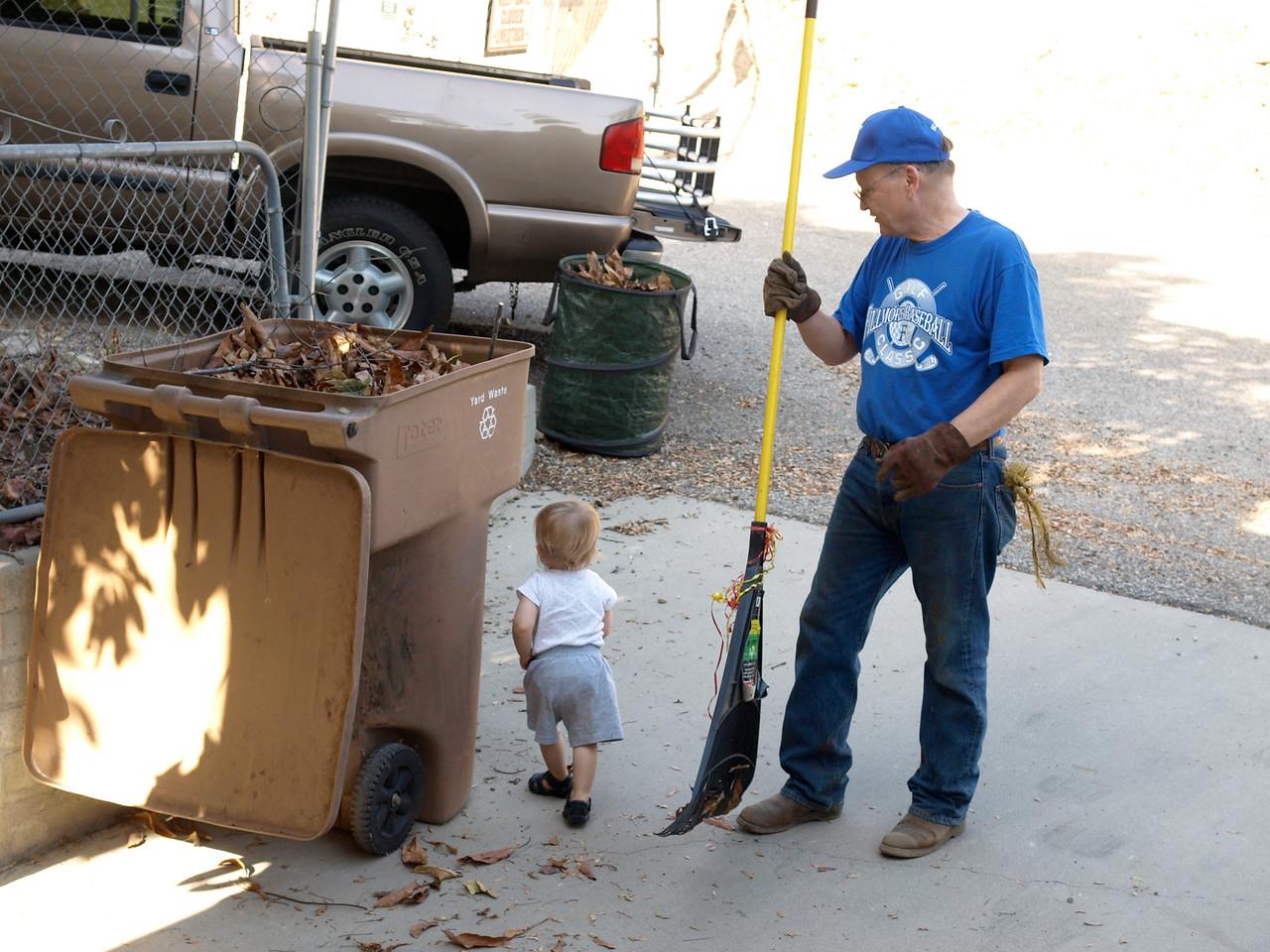 Cody loves helping grandpa putside.