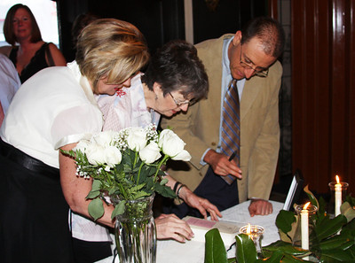 Signing the book for the rehearsal dinner